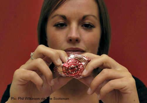 TUNNUCKS BUSINESS STORY FOR  SOS. DROP IN BUSINESS  TERRI YOUNG PICTURED SQUEEZING A TUNNOCKS TEA CAKE AND BREAKING A TUNNOCKS CARAMEL WAFER BAR. pic phil wilkinson / tspl 06/07/2007